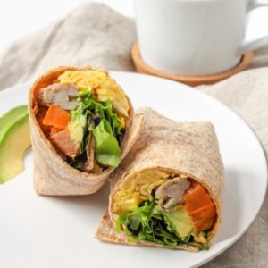 breakfast burrto with rice, avocado, and spinach