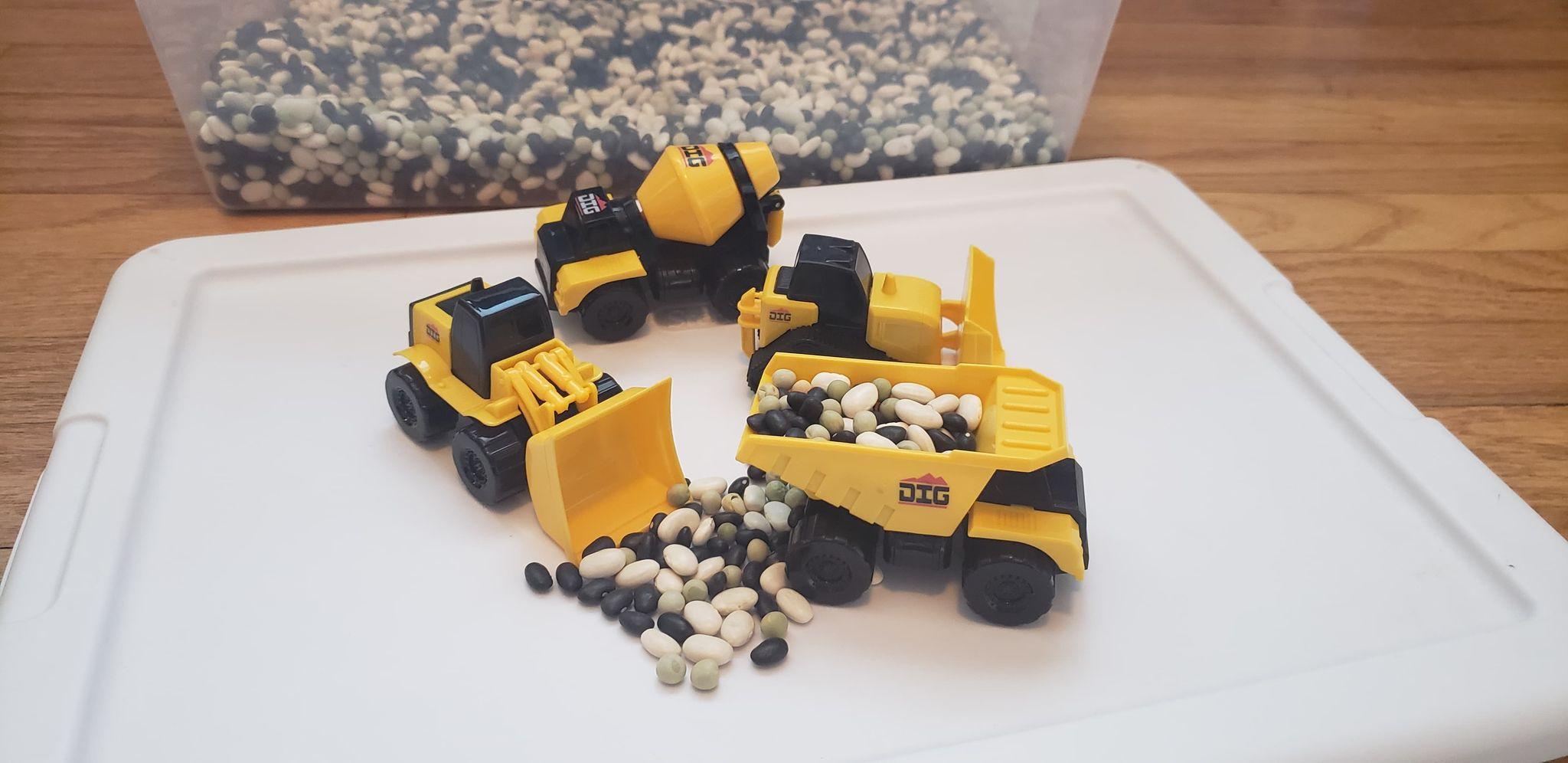four small construction trucks