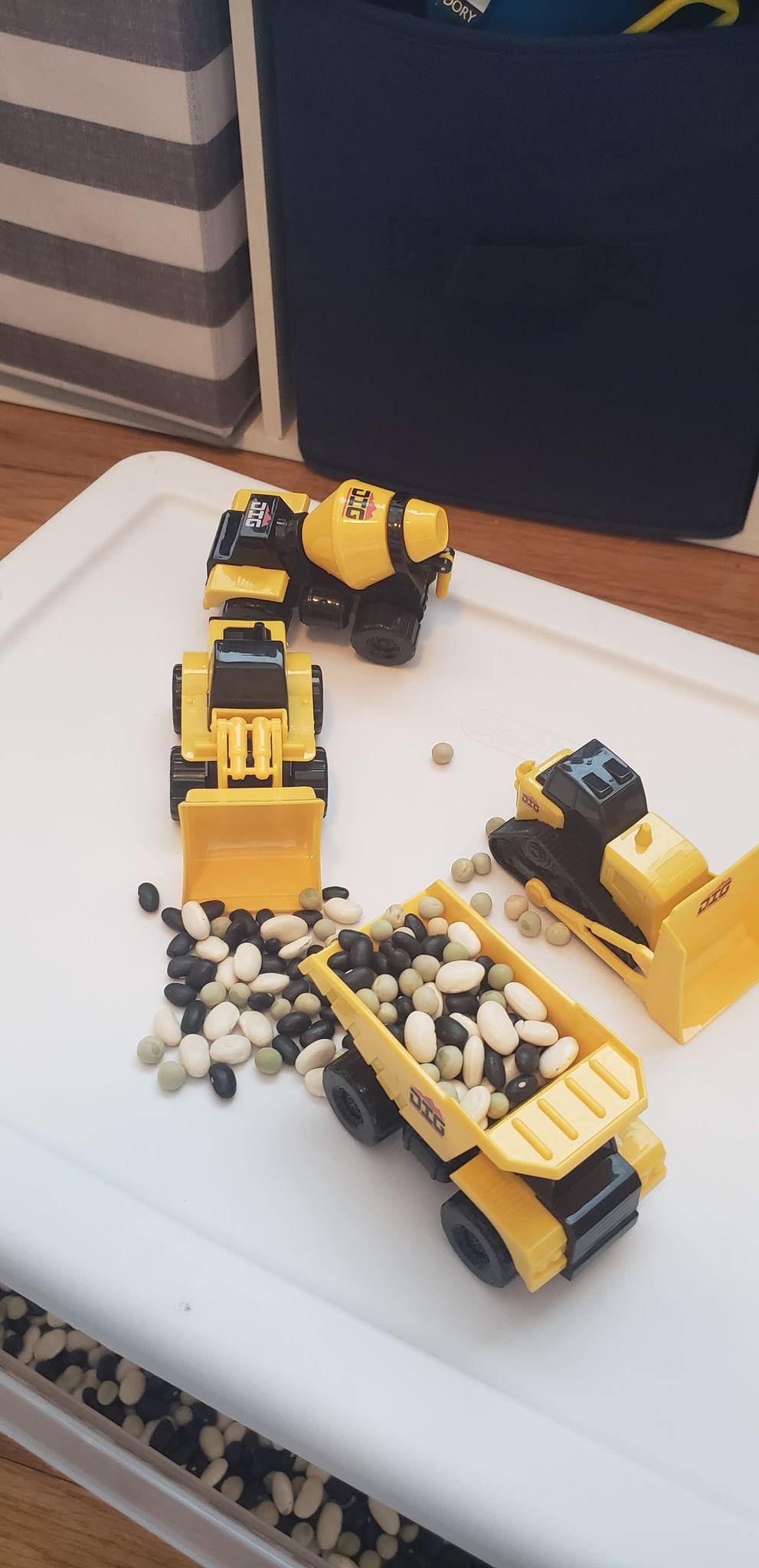 four mini construction vehicles