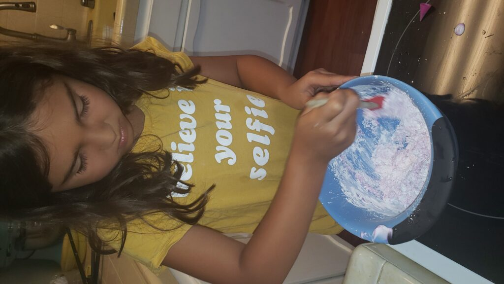 child mixing up playdough