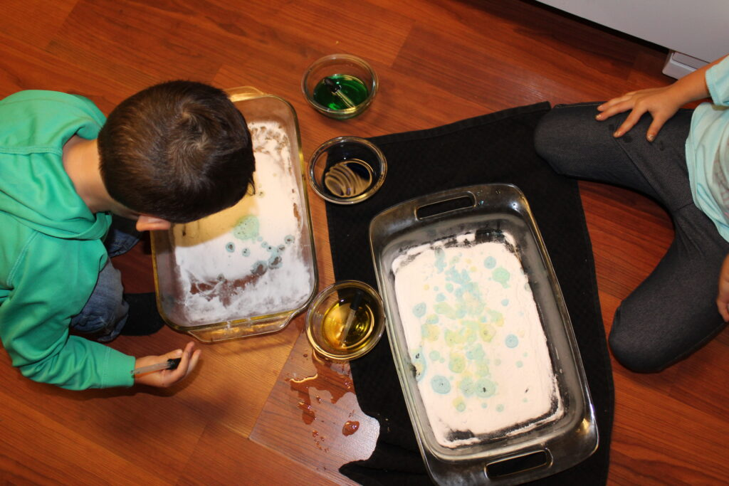 kids making a mess with baking soda and vinegar